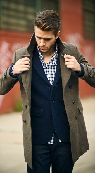 This combination of an olive pea coat and deep blue jeans is perfect for a night out or smart-casual occasions.