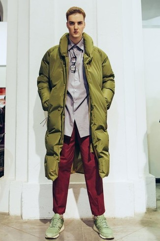 How to wear: olive puffer coat, grey long sleeve shirt, red chinos, olive athletic shoes