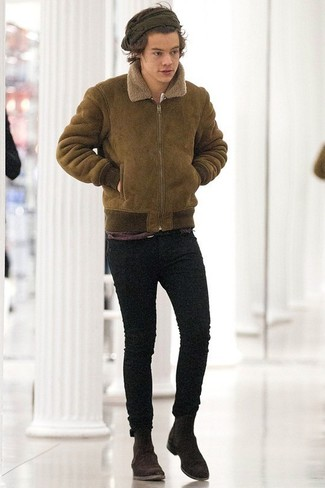Harry Styles wearing Olive Shearling Jacket, Black Skinny Jeans, Dark Brown Suede Chelsea Boots
