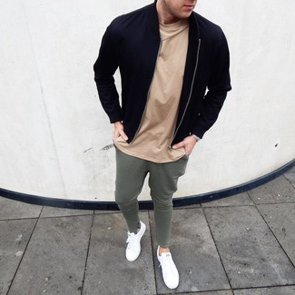 How to wear: white leather low top sneakers, olive sweatpants, tan crew-neck t-shirt, black bomber jacket