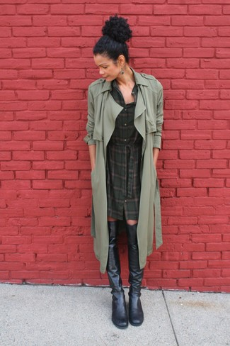 Look absolutely chic without exerting much effort in a Stella McCartney Oversized Trench Coat and a dark green plaid shirtdress. Black leather over the knee boots work amazingly well with this getup. These picks will keep you warm and stylish in summer-to-fall weather.