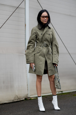 Choose a Stella McCartney women's Oversized Trench Coat for a sleek elegant look. A pair of white leather ankle boots will seamlessly integrate within a variety of looks. This combo is everything for those warm days of spring.