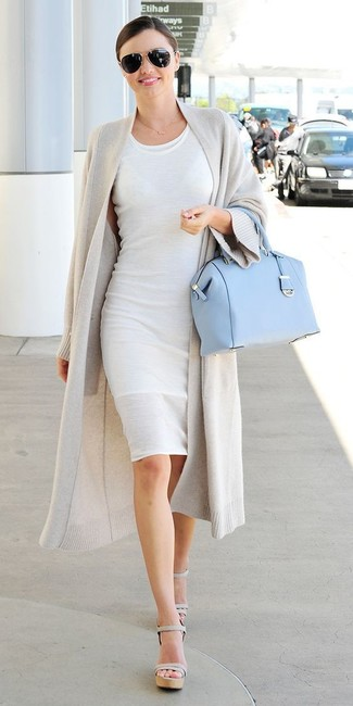 Miranda Kerr wearing Grey Open Cardigan, White Bodycon Dress, Grey Leather Heeled Sandals, Light Blue Leather Satchel Bag