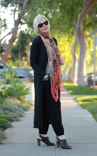 How to wear: black open cardigan, grey crew-neck sweater, black tapered pants, black leather heeled sandals