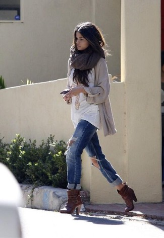 Selena Gomez wearing Beige Knit Open Cardigan, White Print Crew-neck T-shirt, Blue Ripped Boyfriend Jeans, Dark Brown Leather Ankle Boots