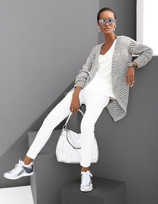 If you're obsessed with relaxed dressing when it comes to fashion, you'll love this absolutely chic combination of a grey textured open cardigan and grey sunglasses. A pair of silver athletic shoes brings the dressed-down touch to the getup. This look is absolutely great to welcome the springtime.