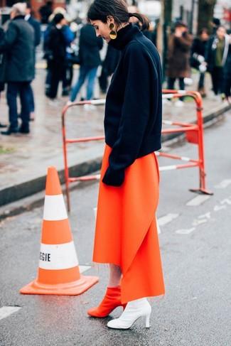 How to wear: gold earrings, orange leather ankle boots, orange midi skirt, black wool turtleneck