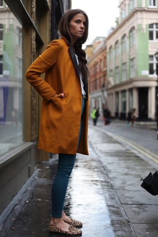 How to wear: orange coat, white crew-neck t-shirt, blue skinny jeans, tan leopard suede loafers