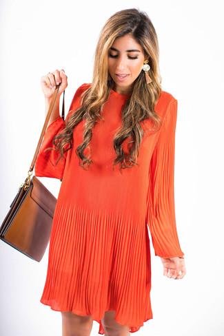 How to wear: orange earrings, brown leather crossbody bag, orange swing dress