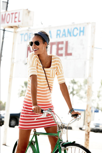 If you're a fan of staying-in clothes which are stylish enough to wear out, try this combination of an orange horizontal striped casual dress and a headband. Loving that this ensemble is great come summer.