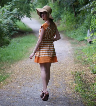 How to wear: orange horizontal striped casual dress, dark brown leather wedge sandals, khaki hat