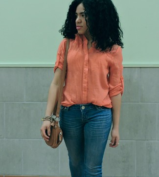 How to wear: orange lightweight button down blouse, blue jeans, brown leather crossbody bag