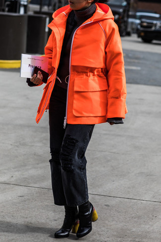 How to wear: orange parka, black turtleneck, black ripped boyfriend jeans, black leather ankle boots