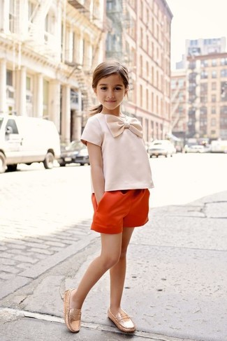 How to wear: orange shorts, gold loafers