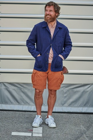 Men's Looks & Outfits: What To Wear In Hot Weather: Reach for a navy linen blazer and orange shorts and you'll pull together a proper and polished getup. If you wish to effortlesslly dress down this ensemble with a pair of shoes, why not complete your outfit with white leather low top sneakers?