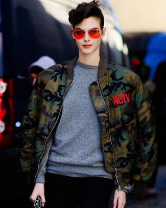 How to wear: orange sunglasses, grey crew-neck sweater, olive camouflage bomber jacket