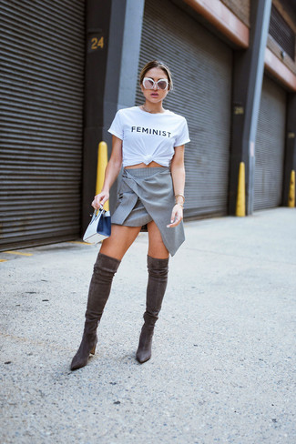 How to wear: white and black leather clutch, dark brown suede over the knee boots, grey a-line skirt, white and black print crew-neck t-shirt