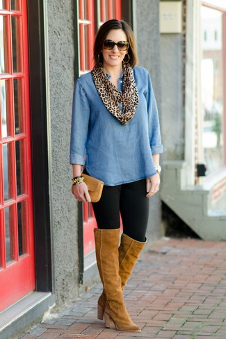 How to wear: tan leather clutch, tan suede over the knee boots, black leggings, blue denim tunic