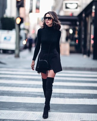 How to wear: black suede crossbody bag, black suede over the knee boots, black mini skirt, black turtleneck