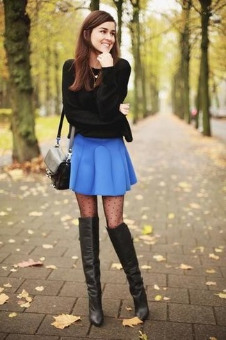 How to wear: black leather crossbody bag, black leather over the knee boots, blue skater skirt, black crew-neck sweater