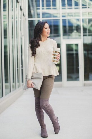 How to wear: grey leather clutch, pink suede over the knee boots, brown skinny jeans, beige crew-neck sweater