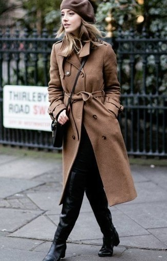 How to wear: black leather crossbody bag, black leather over the knee boots, black skinny jeans, brown trenchcoat