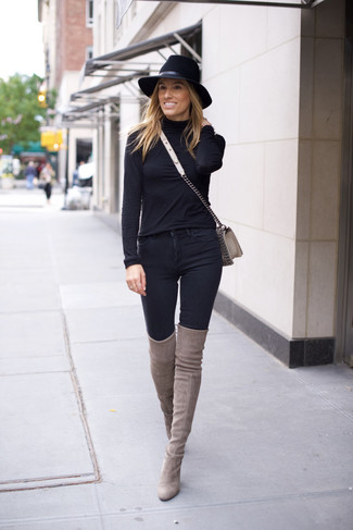 How to wear: grey leather crossbody bag, grey suede over the knee boots, black skinny jeans, black turtleneck