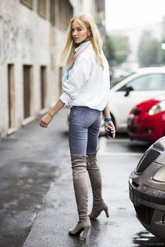 How to wear: multi colored silk scarf, grey suede over the knee boots, blue skinny jeans, white windbreaker