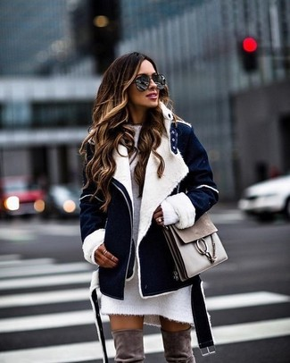 How to wear: grey leather satchel bag, brown suede over the knee boots, white knit sweater dress, navy shearling jacket
