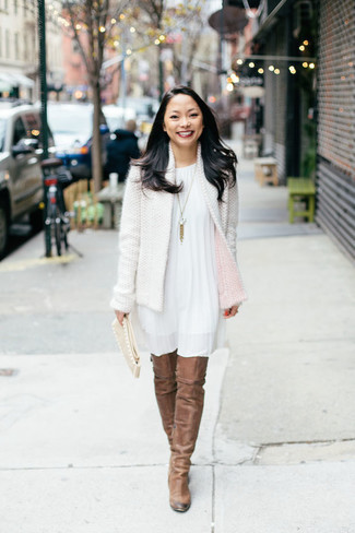 How to wear: beige suede clutch, brown suede over the knee boots, white swing dress, white tweed jacket