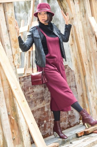 How to wear: burgundy leather ankle boots, burgundy overall dress, black cowl-neck sweater, black leather bomber jacket