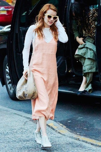 Consider teaming a pink overall dress with Oliver Peoples women's Deep Amber Sunglasses for a casual get-up. Up the ante of your outfit with grey leather ankle boots. We're loving that this combo is ideal when spring comes.
