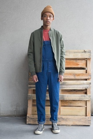 How to Wear a Tan Beanie For Men: Pair an olive bomber jacket with a tan beanie for a stylish and easy-going getup. Add navy and white canvas high top sneakers to the mix to jazz things up.
