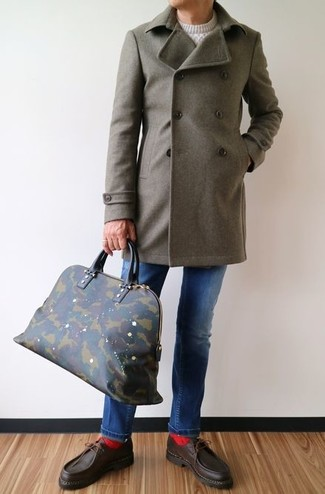 How to wear: olive overcoat, white cable sweater, blue jeans, dark brown leather boat shoes