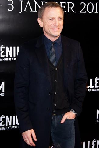 Daniel Craig wearing Navy Overcoat, Black Cardigan, Navy Dress Shirt, Navy Jeans