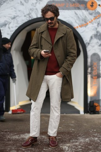 How to wear: olive overcoat, burgundy crew-neck sweater, white chinos, burgundy suede boat shoes