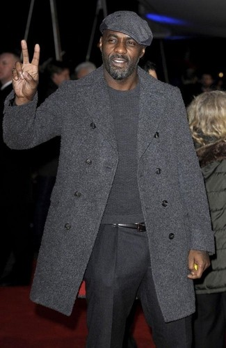 Idris Elba wearing Charcoal Overcoat, Charcoal Crew-neck Sweater, Charcoal Wool Dress Pants, Charcoal Flat Cap