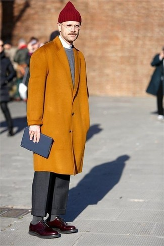 How to wear: mustard overcoat, grey crew-neck sweater, white dress shirt, black dress pants