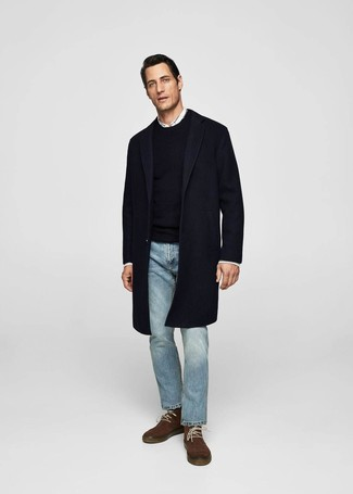How to wear: navy overcoat, black crew-neck sweater, white long sleeve shirt, light blue jeans