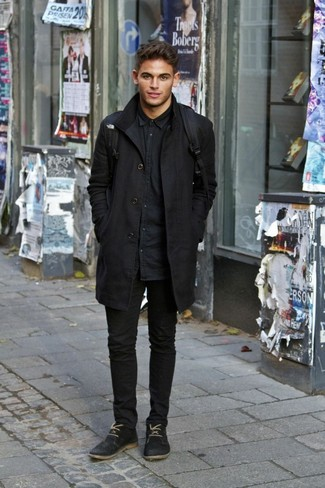 How to wear: black overcoat, black denim shirt, black skinny jeans, black suede derby shoes