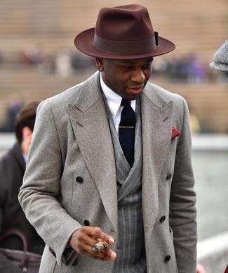 How to wear: grey overcoat, grey vertical striped wool double breasted blazer, white dress shirt, dark brown wool hat