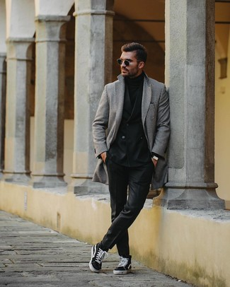 How to wear: black and white houndstooth overcoat, black double breasted blazer, black turtleneck, black dress pants