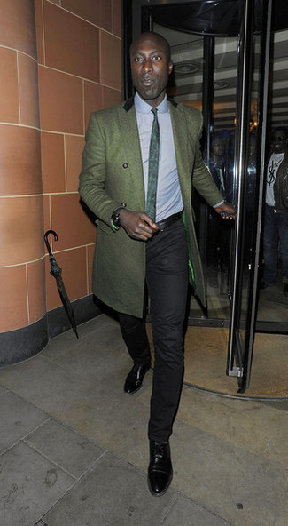 Dermot O'Leary wearing Dark Green Overcoat, Light Blue Dress Shirt, Black Chinos, Black Leather Oxford Shoes