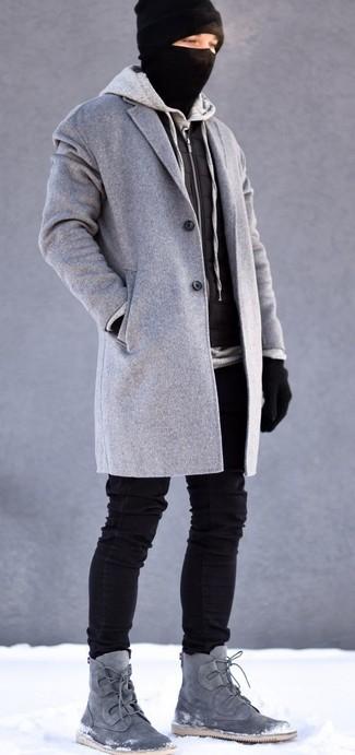How to wear: grey overcoat, black quilted gilet, grey hoodie, black skinny jeans
