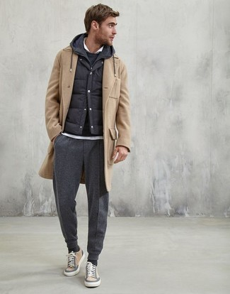 How to wear: camel overcoat, black quilted gilet, black hoodie, white polo