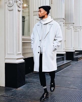How to wear: grey overcoat, grey hoodie, grey turtleneck, black chinos
