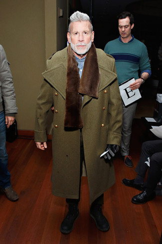 Nick Wooster wearing Olive Overcoat, Blue Chambray Long Sleeve Shirt, Black Chinos, Black Leather Casual Boots