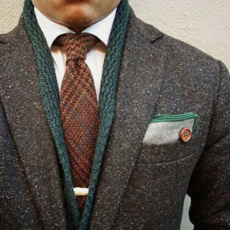 How to wear: charcoal overcoat, dark green shawl cardigan, white dress shirt, brown wool tie