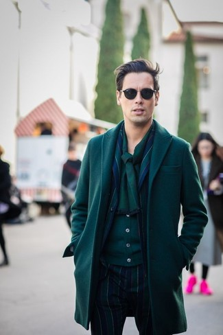How to wear: dark green overcoat, navy vertical striped suit, dark green cardigan, dark green scarf