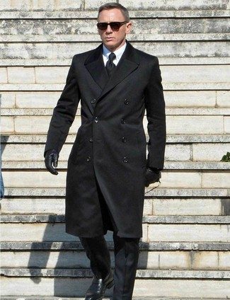 Daniel Craig wearing Black Overcoat, Black Suit, White Dress Shirt, Black Leather Monks
